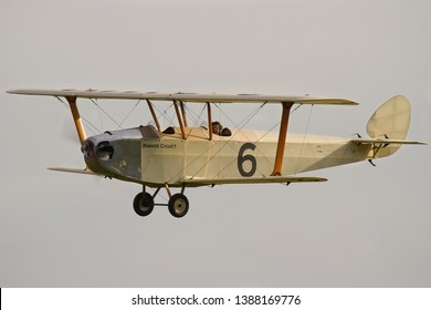 OLD WARDEN, BEDFORDSHIRE, UK – OCTOBEr 5, 2014: 1924 Hawker Cygnet (Replica) G-CAMM, a British ultralight biplane aircraft of the 1920s, on display at Old Warden during a Shuttleworth Airshow.