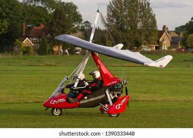 OLD WARDEN, BEDFORDSHIRE, UK – OCTOBER 5, 2014: A red coloured P&M Aviation Quik 912S GT-450 Microlight taxis out to depart out of Old Warden airfield after the Shuttleworth Airshow.