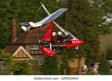 OLD WARDEN, BEDFORDSHIRE, UK – OCTOBER 5, 2014: A red coloured P&M Aviation Quik 912S GT-450 Microlight takes off out of Old Warden airfield after the Shuttleworth Airshow.