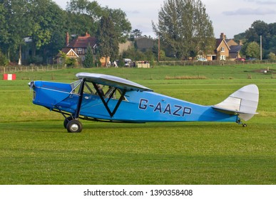 OLD WARDEN, BEDFORDSHIRE, UK – OCTOBER 5, 2014: De Havilland DH.80A Puss Moth G-AAZP taxis out to depart from Old Warden airfield after the Shuttleworth Airshow.