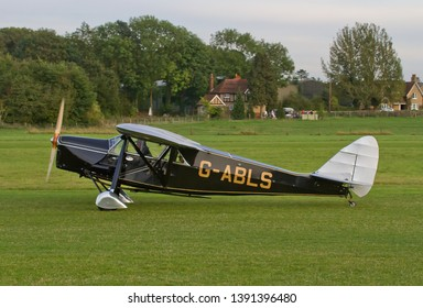 OLD WARDEN, BEDFORDSHIRE, UK – OCTOBER 5, 2014: De Havilland DH.80A Puss Moth G-ABLS, taxis out at Old Warden airfield, ready to take off and display during the Shuttleworth Airshow.