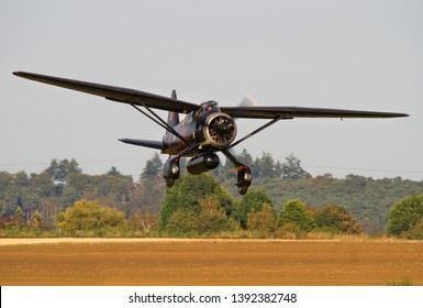OLD WARDEN, BEDFORDSHIRE, UK – OCTOBER 5, 2014: Westland Lysander IIIA V9367 G-AZWT (CN Y1536), in 161 Squadron markings, on approach to land at Old Warden airfield during the Shuttleworth Airshow.