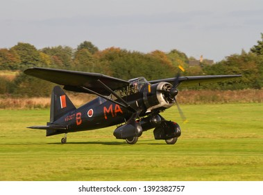 OLD WARDEN, BEDFORDSHIRE, UK – OCTOBER 5, 2014: Westland Lysander IIIA V9367 G-AZWT (CN Y1536), in 161 Squadron markings, lands at Old Warden airfield during the Shuttleworth Airshow.