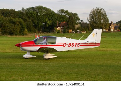 OLD WARDEN, BEDFORDSHIRE, UK – OCTOBER 5, 2014: Robin DR.400-100 Cadet G-BSVS taxis out to depart from Old Warden airfield at the end of the Shuttleworth Airshow.
