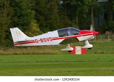 OLD WARDEN, BEDFORDSHIRE, UK – OCTOBER 5, 2014: Robin DR.400-100 Cadet G-BSVS takes off from Old Warden airfield at the end of the Shuttleworth Airshow.
