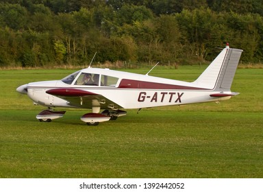 OLD WARDEN, BEDFORDSHIRE, UK – OCTOBER 5, 2014: Piper PA-28-180 Cherokee C G-ATTX taxis out for departure at Old Warden airfield at the end of the Shuttleworth Airshow.