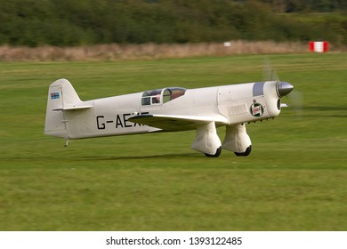 OLD WARDEN, BEDFORDSHIRE, UK – OCTOBER 5, 2014: 1936 Percival E-2H Mew Gull G-AEXF takes off from Old Warden airfield to carry out a display during the Shuttleworth Airshow.