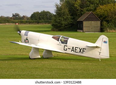 OLD WARDEN, BEDFORDSHIRE, UK – OCTOBER 5, 2014: 1936 Percival E-2H Mew Gull G-AEXF taxis in at Old Warden airfield after landing from a display in the Shuttleworth Airshow.