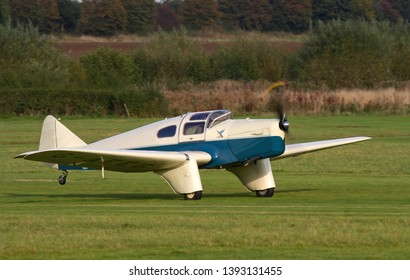 OLD WARDEN, BEDFORDSHIRE, UK – OCTOBER 5, 2014: Miles M3A Falcon Major G-AEEG takes off from Old Warden during the Shuttleworth Airshow.
