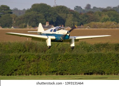 OLD WARDEN, BEDFORDSHIRE, UK – OCTOBER 5, 2014: Miles M3A Falcon Major G-AEEG makes its approach to land at Old Warden during the Shuttleworth Airshow.