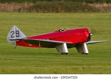 OLD WARDEN, BEDFORDSHIRE, UK – OCTOBER 5, 2014: Chilton DW.1 G-AESZ, a British light sporting monoplane from the 1930s,takes off from Old Warden airfield during the Shuttleworth Airshow.
