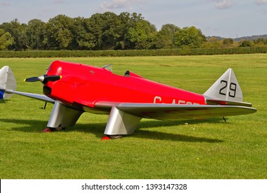 OLD WARDEN, BEDFORDSHIRE, UK – OCTOBER 5, 2014: Chilton DW.1 G-AESZ, a British light sporting monoplane from the 1930s, on static display at Old Warden airfield during the Shuttleworth Airshow.
