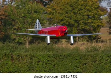 OLD WARDEN, BEDFORDSHIRE, UK – OCTOBER 5, 2014: Chilton DW.1 G-AESZ, a British light sporting monoplane from the 1930s, approaches to land at Old Warden airfield during the Shuttleworth Airshow.