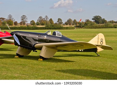 OLD WARDEN, BEDFORDSHIRE, UK – OCTOBER 5, 2014: Miles M.2L Hawk Speed Six G-ADGP, a 1930s British two-seat light monoplane, on static display at Old Warden airfield during the Shuttleworth Airshow.
