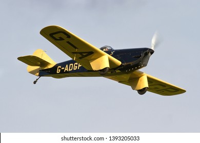 OLD WARDEN, BEDFORDSHIRE, UK – OCTOBER 5, 2014: Miles M.2L Hawk Speed Six G-ADGP, a 1930s British two-seat light monoplane, displays over Old Warden airfield during the Shuttleworth Airshow.