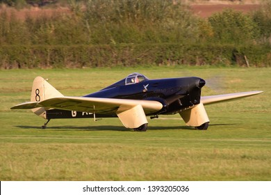 OLD WARDEN, BEDFORDSHIRE, UK – OCTOBER 5, 2014: Miles M.2L Hawk Speed Six G-ADGP, a 1930s British two-seat light monoplane, takes off from Old Warden airfield during the Shuttleworth Airshow.
