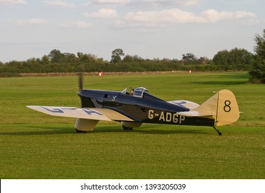 OLD WARDEN, BEDFORDSHIRE, UK – OCTOBER 5, 2014: Miles M.2L Hawk Speed Six G-ADGP, a 1930s British two-seat light monoplane, taxis out at Old Warden airfield during the Shuttleworth Airshow.