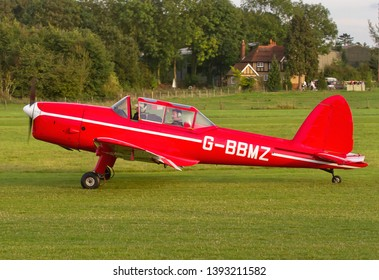OLD WARDEN, BEDFORDSHIRE, UK – OCTOBER 5, 2014: 1950 De Havilland DHC-1 Chipmunk T.10 G-BBMZ taxis for departure at Old Warden airfield after the Shuttleworth Airshow.