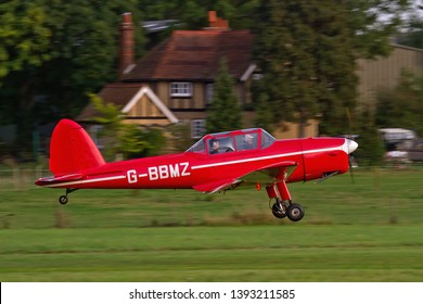 OLD WARDEN, BEDFORDSHIRE, UK – OCTOBER 5, 2014: 1950 De Havilland DHC-1 Chipmunk T.10 G-BBMZ takes off from Old Warden airfield after the Shuttleworth Airshow.
