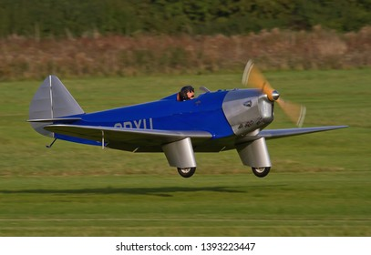 OLD WARDEN, BEDFORDSHIRE, UK – OCTOBER 5, 2014: Chilton DW.1 G-CDXU, a British light sporting monoplane from the 1930s, lands at Old Warden airfield during the Shuttleworth Airshow.