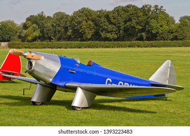 OLD WARDEN, BEDFORDSHIRE, UK – OCTOBER 5, 2014: Chilton DW.1 G-CDXU, a British light sporting monoplane from the 1930s, on static display at Old Warden airfield during the Shuttleworth Airshow.
