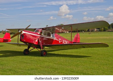 OLD WARDEN, BEDFORDSHIRE, UK – OCTOBER 5, 2014: De Havilland DH-87B Hornet Moth G-ADKL on static display on the flight line at Old Warden airfield during the Shuttleworth Airshow.