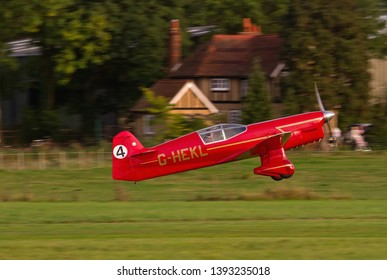 OLD WARDEN, BEDFORDSHIRE, UK – OCTOBER 5, 2014: Beale Replica Percival Mew Gull G-HEKL takes off from Old Warden at the end of the Shuttleworth Airshow.
