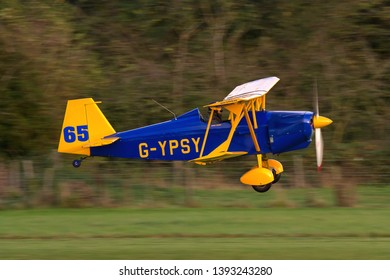 OLD WARDEN, BEDFORDSHIRE, UK – OCTOBER 5, 2014: Andreasson BA-4B 65 G-YPSY, a single-seat aerobatic biplane, taxis out for departure at Old Warden airfield, at the end of the Shuttleworth Airshow.