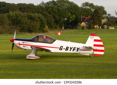 OLD WARDEN, BEDFORDSHIRE, UK – OCTOBER 5, 2014: Mudry CAP-10B G-BYFY, a two-seat training aerobatic aircraft first built in 1970, taxis out for departure at Old Warden after the day's airshow.