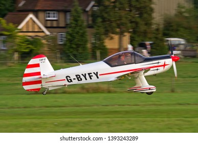 OLD WARDEN, BEDFORDSHIRE, UK – OCTOBER 5, 2014: Mudry CAP-10B G-BYFY, a two-seat training aerobatic aircraft first built in 1970, takes off from Old Warden after the Shuttleworth Airshow.
