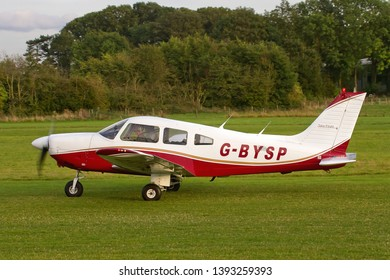 OLD WARDEN, BEDFORDSHIRE, UK – OCTOBER 5, 2014: Piper PA-28-181 Archer II G-BYSP taxis out on departure from Old Warden airfield at the end of the Shuttleworth Airshow.