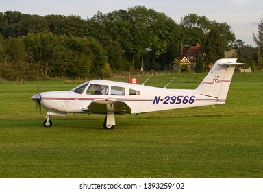 OLD WARDEN, BEDFORDSHIRE, UK – OCTOBER 5, 2014: Piper PA-28RT-201 Arrow IV N29566 taxis out to depart from Old Warden airfield at the end of the Shuttleworth Airshow.