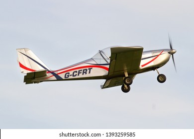 OLD WARDEN, BEDFORDSHIRE, UK – OCTOBER 5, 2014: Evektor EV-97 TeamEurostar UK G-CFRT takes off from Old Warden airfield at the end of the Shuttleworth Airshow.