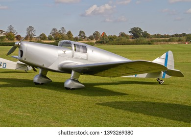 OLD WARDEN, BEDFORDSHIRE, UK – OCTOBER 5, 2014: 1936 Miles M11A Whitney Straight G-AERV on static display on the flight line at Old Warden airfield prior to the Shuttleworth Airshow.
