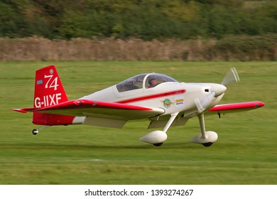 OLD WARDEN, BEDFORDSHIRE, UK – OCTOBER 5, 2014: Vans RV-7 G-IIXF, a two-seat, single-engine, low-wing homebuilt airplane, lands at Old Warden during the Shuttleworth Airshow.