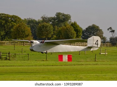 OLD WARDEN, BEDFORDSHIRE, UK – OCTOBER 5, 2014: English Electric Wren No. 4 G-EBNV, flies along the grass strip runway at Old Warden airfield during the Shuttleworth Airshow.
