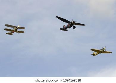 OLD WARDEN, BEDFORDSHIRE, UK – OCTOBER 5, 2014: Westland Lysander IIIA V9367 G-AZWT, Gloster Gladiator L8032 G-AMRK and Hawker Sea Hurricane Mk. IB 7-L Z7015 G-BKTH display together at Old Warden.
