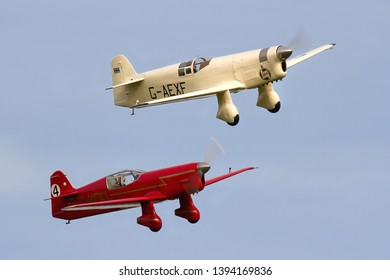 OLD WARDEN, BEDFORDSHIRE, UK – OCTOBER 5, 2014: Percival Mew Gull G-AEXF and Beale Replica Percival Mew Gull G-HEKL display together at Old Warden during the Shuttleworth Airshow.