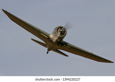 OLD WARDEN, BEDFORDSHIRE, UK – OCTOBER 5, 2014: Spartan 7W Executive NC17615, a popular cabin monoplane of the 1940's, passes over Old Warden airfield during the Shuttleworth Airshow.