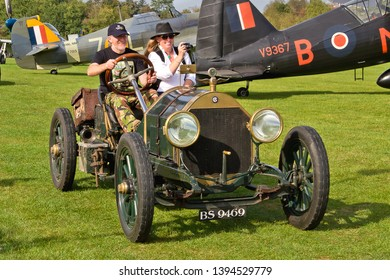 OLD WARDEN, BEDFORDSHIRE, UK – OCTOBER 5, 2014: 1913 Chalmers Model 17 vintage sports car, registration BS9469, participates in the vehicle parade at Old Warden airfield.