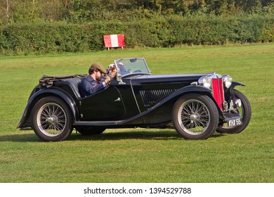 OLD WARDEN, BEDFORDSHIRE, UK – OCTOBER 5, 2014: 1937 MG TA Midget Roadster, registration KHX55, participates in the vehicle parade at Old Warden airfield prior to the start of the Shuttleworth Airshow
