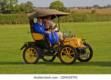 OLD WARDEN, BEDFORDSHIRE, UK – OCTOBER 5, 2014: 1902 Baby Peugeot, registration AA1417, participates in the vehicle parade at Old Warden airfield prior to the start of the Shuttleworth Airshow.