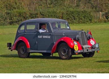 OLD WARDEN, BEDFORDSHIRE, UK – OCTOBER 5, 2014: 1938 Hillman Minx RAF Bomb Disposal Car RAF184832, registration HSL 958, participates in the vehicle parade at Old Warden airfield.