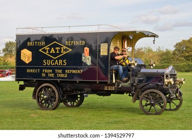 OLD WARDEN, BEDFORDSHIRE, UK – OCTOBER 5, 2014: 1913 McCurd 5 Ton Box Van registration BC2365, in Henry Tate Sugars livery, participates on the vehicle parade at Old Warden.