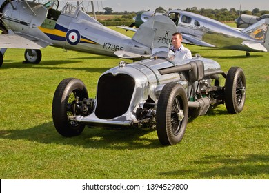 OLD WARDEN, BEDFORDSHIRE, UK – OCTOBER 5, 2014: 1933 Napier-Railton racing car, participates in the vehicle parade at Old Warden airfield, prior to the start of the Shuttleworth Airshow.