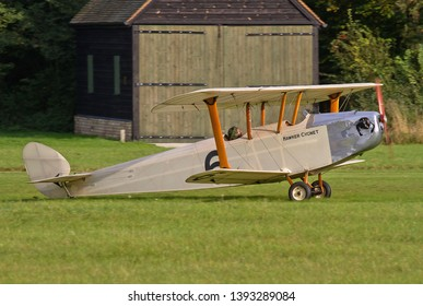OLD WARDEN, BEDFORDSHIRE, UK – OCTOBER5, 2014: 1924 Hawker Cygnet (Replica) G-CAMM, a British ultralight biplane aircraft of the 1920s, lands at Old Warden during a Shuttleworth Airshow.