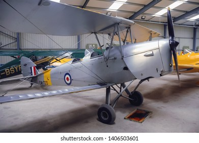 Old Warden, UK - September 27, 2006: De Havilland DH 82A Tiger Moth aircraft in Shuttleworth Collection museum located at Aerodrome in Old Warden village