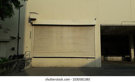 Old warehouse, white door.building warehouse steel industrial