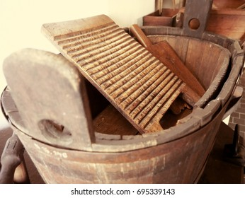 Old washing method, old wooden trough with washboard.  Toned style photo.