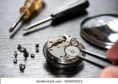 old watch repair composition with magnifier and screwdrivers